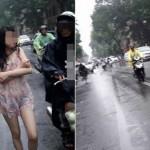 Hành động quá khó hiểu của cô gái giữa phố Hà Nội ngày mưa